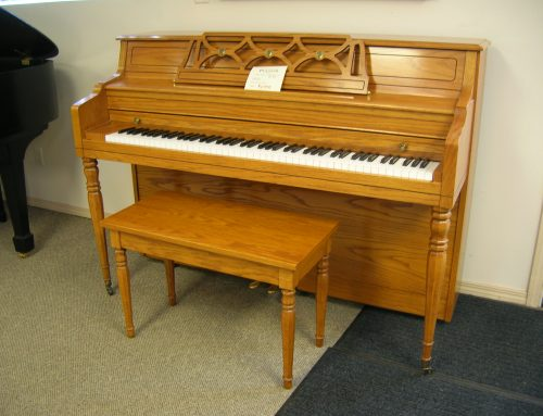 1996 Kawai model 502M 42″ oak console piano
